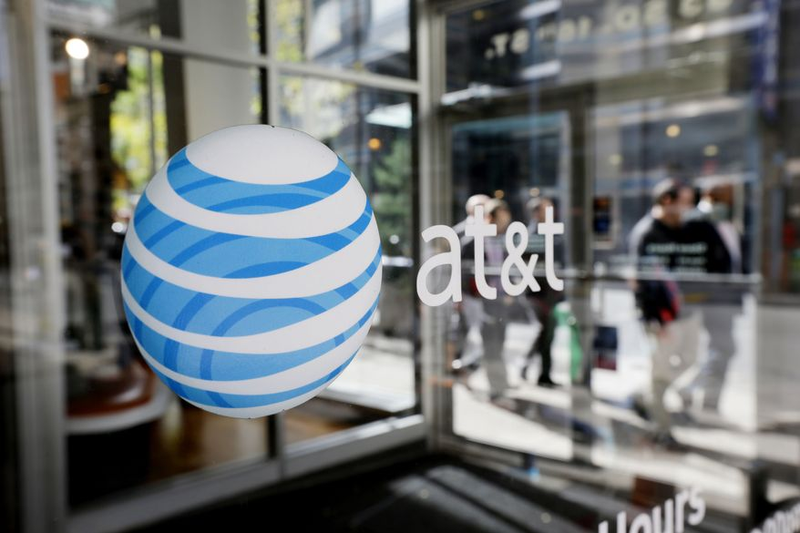 """In this Wednesday, Oct. 17, 2012, file photo, an AT&T logo is displayed on an AT&T Wireless retail store front, in Philadelphia. (AP Photo/Matt Rourke)"""" ** FILE **"""
