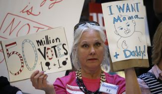 Joani Allen, an opponent of same-sex marriage, holds a sign during a rally at the Utah State Capitol Tuesday, April 28, 2015, in Salt Lake City. Supporters and opponents of same-sex marriage rallied in Utah on Tuesday after the U.S. Supreme Court heard arguments on the constitutionality of laws banning such marriages. (AP Photo/Rick Bowmer)