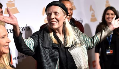In this Feb.7, 2015 file photo, Joni Mitchell arrives at the 2015 Clive Davis Pre-Grammy Gala at the Beverly Hilton Hotel in Beverly Hills, Calif. Mitchell was hospitalized in Los Angeles on Tuesday, March 31, 2015 according to the Twitter account and website of the folk singer and Rock and Roll Hall of Famer, but details on her condition have not been released.  (Photo by John Shearer/Invision/AP, File)