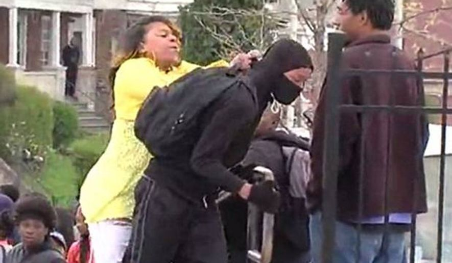Baltimore affiliate WMAR captured an irate mother hauling her son away from the scene of rioting.