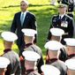 President Barack Obama and Japanese Prime Minister Shinzo Abe review the troops on the South Lawn of the White House in Washington, Tuesday, April 28, 2015, during a state arrival ceremony. (AP Photo/Andrew Harnik)