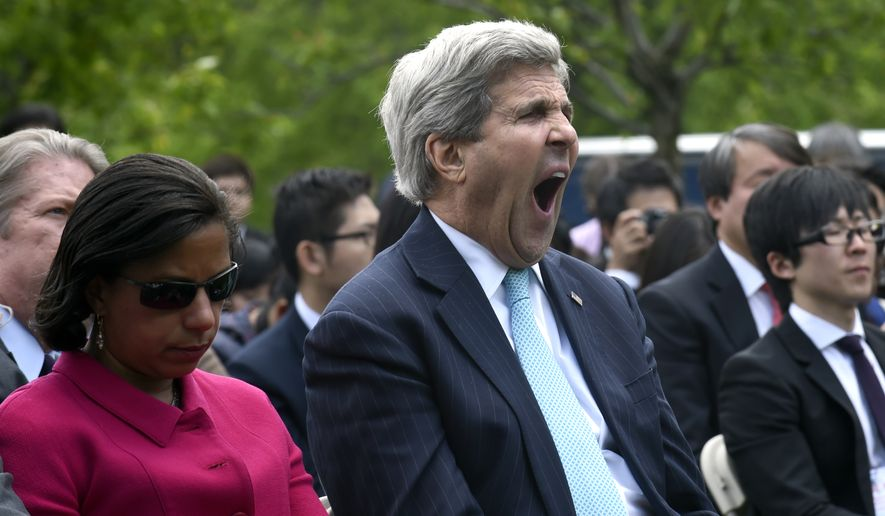 Secretary of State John Kerry, sitting next to National Security Adviser Susan Rice, yawns during a joint news conference between President Barack Obama and Japanese Prime Minister Shinzo Abe , Tuesday, April 28, 2015,in the Rose Garden of the White House in Washington.  (AP Photo/Susan Walsh)