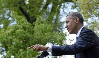 President Barack Obama speaks during a news conference with Japanese Prime Minister Shinzo Abe, Tuesday, April 28, 2015, in the Rose Garden of the White House in Washington.  (AP Photo/Susan Walsh)