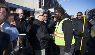 Gov. Larry Hogan, R-Md., meets with volunteers cleaning up after an evening of riots following the funeral of Freddie Gray on Tuesday, April 28, 2015, in Baltimore. (AP Photo/Evan Vucci) ** FILE **