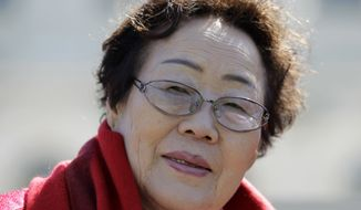 Yong Soo Lee, of South Korea is seen of the West Lawn of the Capitol Hill in Washington, Tuesday, April 28, 2015. Yong Soo Lee is one of dozens of surviving comfort women from Korea other Asian countries that were forced into sexual servitude by Japanese troops. (AP Photo/Luis M. Alvarez)