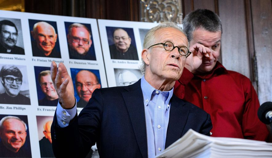 Troy Bramlage wipes his eyes after attorney Jeff Anderson played a recording of the Rev. Allen Tarlton's deposition in which he admitted abusing children, Tuesday, April 28, 2015, in St. Paul, Minn. Bramlage has settled a lawsuit with St. John's Abbey that will force the release of personnel files for 19 monks accused of sexually abusing minors, attorneys said Monday. Anderson sued St. John's in 2013 on behalf of Bramlage III, 52, who said he was abused by the Rev. Allen Tarlton when he was a 14-year-old freshman at its prep school in 1977. (Glen Stubbe/Star Tribune via AP)  MANDATORY CREDIT; ST. PAUL PIONEER PRESS OUT; MAGS OUT; TWIN CITIES LOCAL TELEVISION OUT