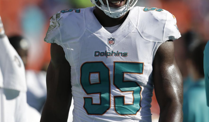 FILE - In this Sunday, Dec. 28, 2014 file photo, Miami Dolphins defensive end Dion Jordan (95) walks the sidelines during the first half of an NFL football game New York Jets in Miami Gardens, Fla. The Dolphins and the NFL announced Tuesday, April 28, 2015 that Jordan has been suspended for the 2015 season for violating the NFL Policy and Program for Substances of Abuse.  (AP Photo/Wilfredo Lee, File)
