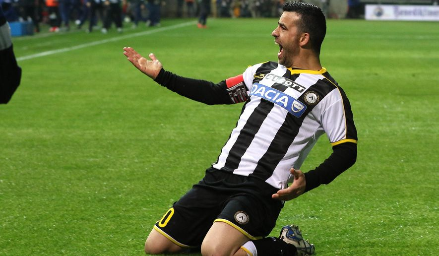 Udinese's Antonio Di Natale celebrates after scoring during a Serie A soccer match between Udinese and Inter Milan at the Friuli stadium in Udine, Italy, Tuesday, April 28, 2015. (AP Photo/Paolo Giovannini)