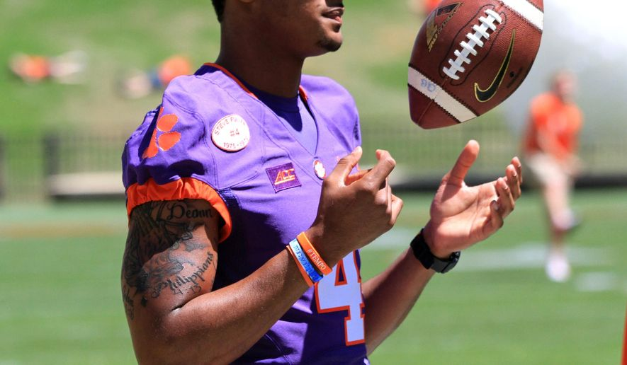 FILE - In this April 11, 2015, file photo, quarterback Deshaun Watson tosses a ball before Clemson's  NCAA college football spring game at Memorial Stadium in Clemson, S.C. Deshaun Watson was the most talked about player this spring without ever taking a snap. (Mark Crammer/Anderson Independent-Mail via AP, File)