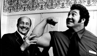 In this Oct. 6, 1972, file photo, wrestler Ken Patera, right, poses with promoter Verne Gagne in Minneapolis.  Gagne, one of professional wrestling's most celebrated performers and promoters died on Monday, April 27, 2015 at age 89. (Powell Kruege/Star Tribune via AP)