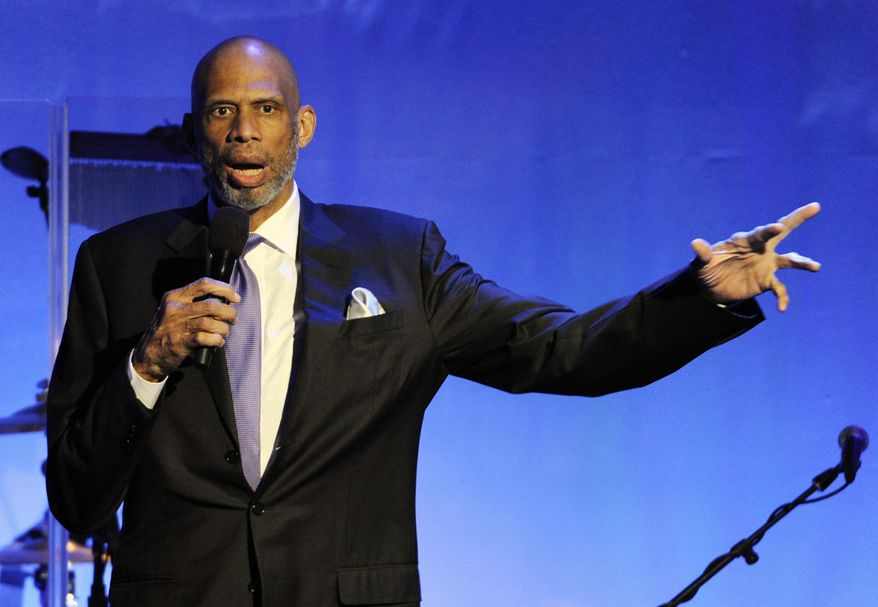 Retired basketball Hall of Famer Kareem Abdul-Jabbar addresses an audience during the 2014 Carousel of Hope Ball in Beverly Hills, California, Oct. 11, 2014. (Photo by Chris Pizzello/Invision/AP) ** FILE **