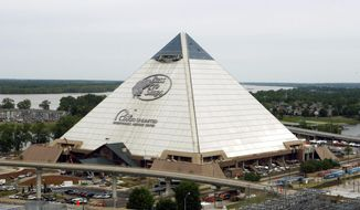In this April 27, 2015 photo, the new Bass Pro Shop store stands near the Mississippi River in Memphis, Tenn. The store, which opens April 29, is in the Memphis landmark known as the Pyramid. Bass Pro and the city agreed on a 55-year-lease in 2010, and construction to convert the 535,000-square foot building from arena to megastore began four years ago. (AP Photo/Karen Pulfer Focht)