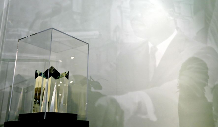 """A new sculpture honoring Martin Luther King, Jr. is displayed after a rededication ceremony at the Empire State Plaza Concourse, Wednesday, April 29, 2015, in Albany, N.Y. The previous sculpture, which was dedicated in 2000, was damaged over the Fourth of July weekend. Despite an investigation by the State Police, officials were unable to determine whether the damage was accidental or the result of vandalism. Entitled """"Seeds of Enlightenment,"""" the work is the centerpiece of a small memorial for the civil rights leader in the concourse below the Capitol building.  (AP Photo/Mike Groll)"""