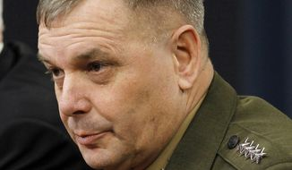 In this April 21, 2011, file photo, Gen. James Cartwright takes part in a news conference at the Pentagon. A former commander of U.S. nuclear forces is leading a call for taking U.S. and Russian nuclear missiles off high alert, arguing that a longer fuse could keep a possible cyberattack from starting a nuclear war and would mean less risk of miscalculation in a crisis. (AP Photo/Alex Brandon, File)