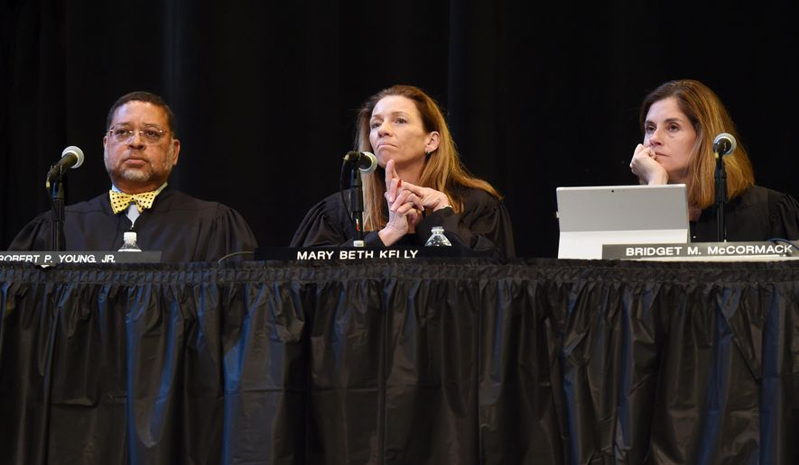 The Michigan Supreme Court, from left to right, Chief Justice Robert P. Young, Jr., Justice Mary Beth Kelly, Justice Bridget Mary McCormack listen during oral arguments in a case at Pioneer High School on Wednesday, April 29, 2015 in Ann Arbor, Mich. (Melanie Maxwell/The Ann Arbor News via AP) LOCAL TELEVISION OUT; LOCAL INTERNET OUT
