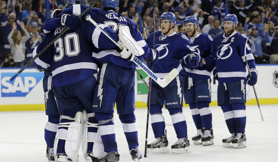 Tampa Bay Lightning players celebrate their 2-0 win over the Detroit Red Wings during Game 7 of a first-round NHL Stanley Cup hockey playoff series Wednesday, April 29, 2015, in Tampa, Fla. (AP Photo/Chris O'Meara)