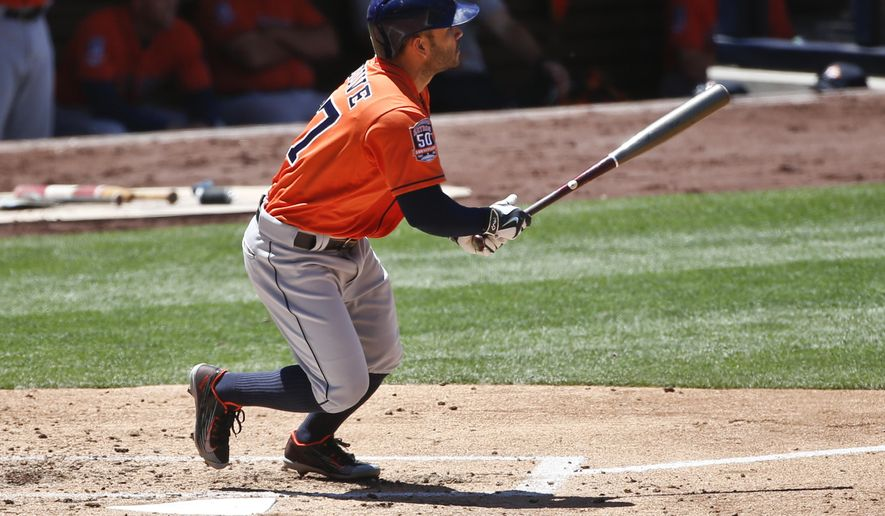 Houston Astros' Jose Altuve watches his deep sacrifice fly to left that drove in Jake Marisnick from third base in the third inning of a baseball game against the San Diego Padres Wednesday April 29, 2015 in San Diego.   (AP Photo/Lenny Ignelzi)