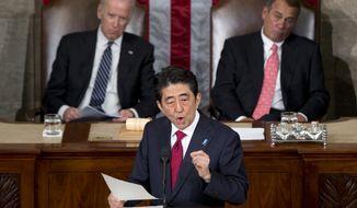 Japanese Prime Minister Shinzo Abe speaks before a joint meeting of Congress, Wednesday, April 29, 2015, on Capitol Hill in Washington. Vice President Joe Biden, left, and House Speaker John Boehner of Ohio listen. (AP Photo/Carolyn Kaster)