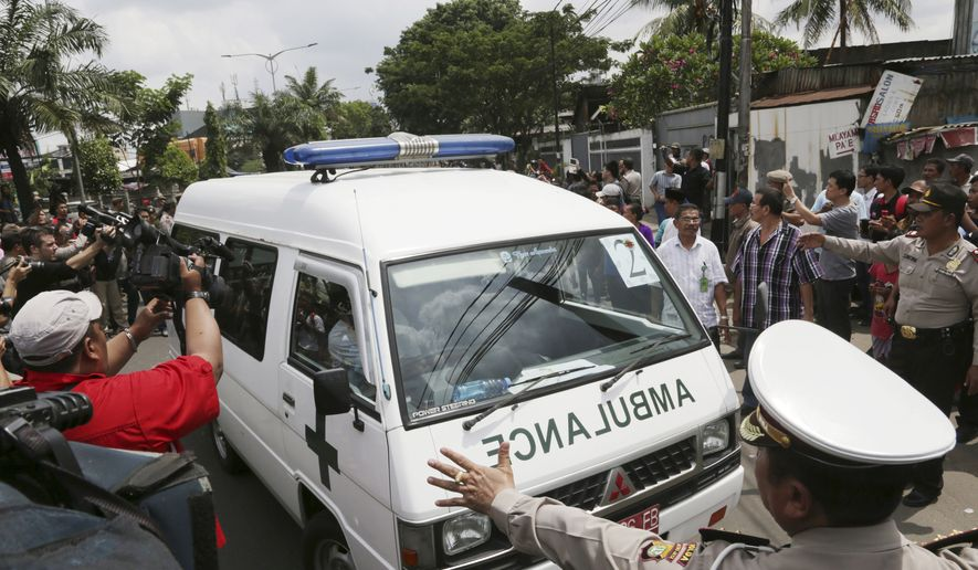 One of ambulances carrying the bodies of Australian death-row prisoners Andrew Chan and Myuran Sukumaran arrives at a funeral home in Jakarta, Indonesia, Wednesday, April 29, 2015. (AP Photo/Achmad Ibrahim)