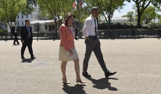 President Barack Obama takes a walk along Pennsylvania Avenue in Washington, Wednesday, April 29, 2015, with 2015 National Teacher of the Year Shanna Peeples of Amarillo, Texas, following an event to honor the 2015 National Teacher of the Year and finalists in the Rose Garden. (AP Photo/Susan Walsh)