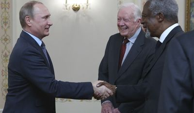 Russian President Vladimir Putin, left, greets former U.S. president Jimmy Carter and former U.N. Secretary-General Kofi Annan, right, as he meets with members of the Elders group in the Novo-Ogaryovo residence outside Moscow, Russia, Wednesday, April 29, 2015. (Sergei Karpukhin/Pool Photo via AP)