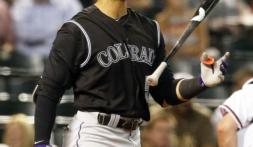Colorado Rockies right fielder Carlos Gonzalez (5) reacts after striking out against the Arizona Diamondbacks in the fifth inning during a baseball game, Tuesday, April 28, 2015, in Phoenix. (AP Photo/Rick Scuteri)