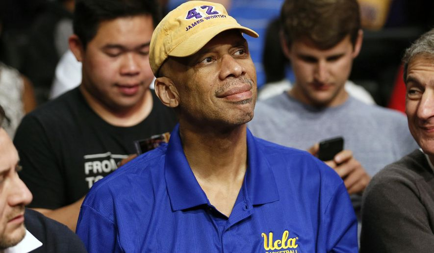 FILE - This April 1, 2014,  file photo shows former Los Angeles Lakers player Kareem Abdul-Jabbar at an NBA basketball ball game in Los Angeles. Abdul-Jabbar has briefly returned to the hospital two weeks after undergoing quadruple coronary bypass surgery, but his business manager said Wednesday, April 29, 2015, it was just a precaution and the NBA's career scoring leader is doing fine. (AP Photo/Danny Moloshok, File)