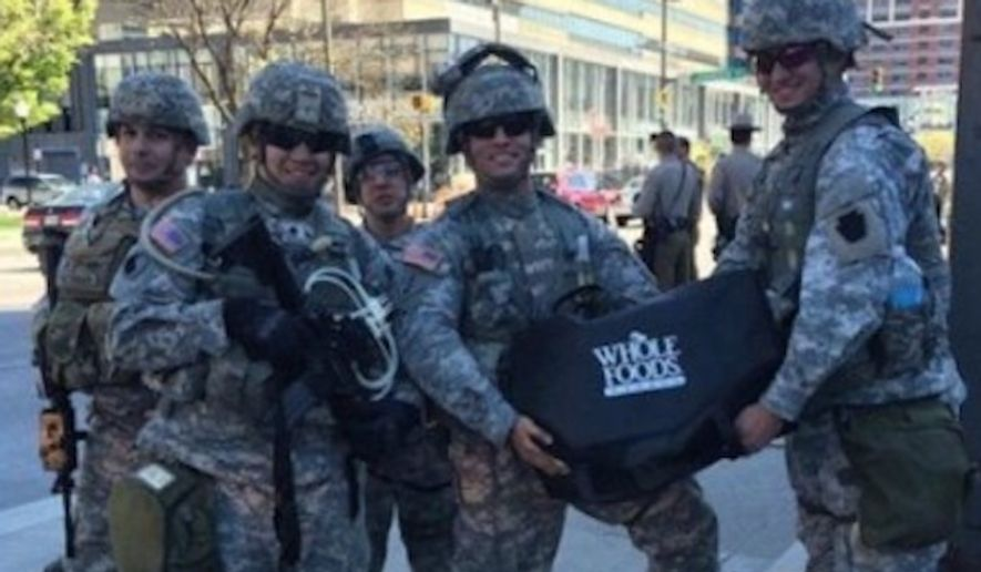 Whole Foods is defending its decision to serve lunch to National Guardsman patrolling the streets of Baltimore on Tuesday, despite an outcry from online commenters who argue the food should have gone to the local community. (Facebook)