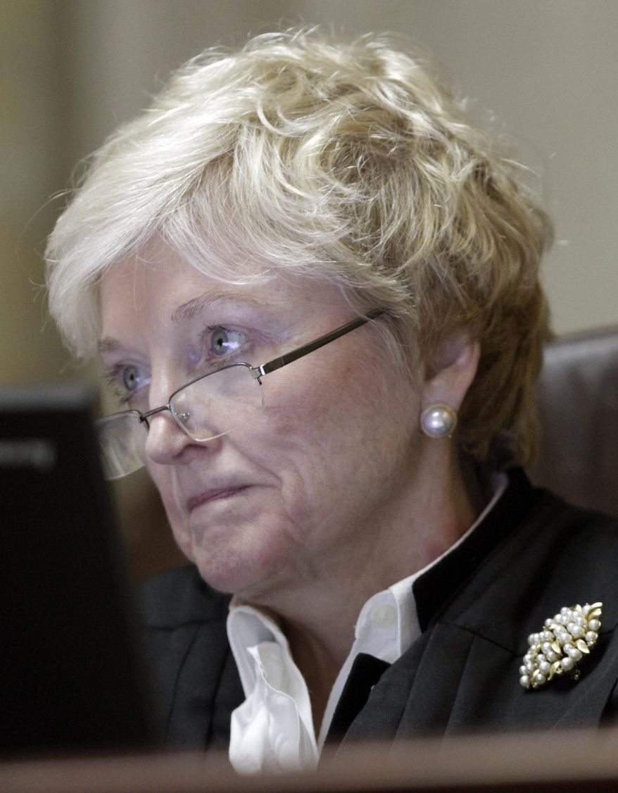 FILE - In this Nov. 11, 2013 file photo, Wisconsin Supreme Court justice Patience D. Roggensack listens to arguments at the state Capitol in Madison, Wis. Documents released Thursday, April 30, 2015 show Roggensack cast the deciding vote for herself to replace longtime Chief Justice Shirley Abrahamson.  (M.P. King/Wisconsin State Journal via AP, Pool)