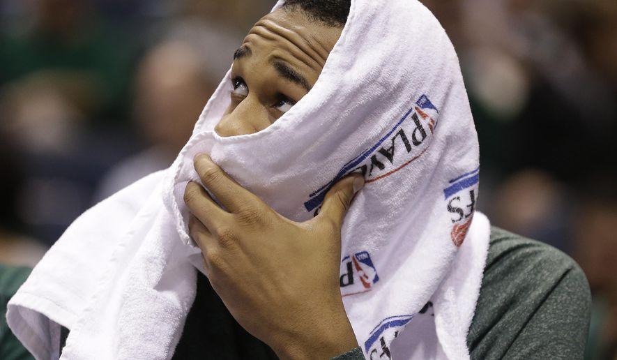 Milwaukee Bucks' John Henson watches the second half of Game 6 against the Chicago Bulls during an NBA basketball first-round playoff series Thursday, April 30, 2015, in Milwaukee. Chicago won 120-66 to win the series. (AP Photo/Jeffrey Phelps)