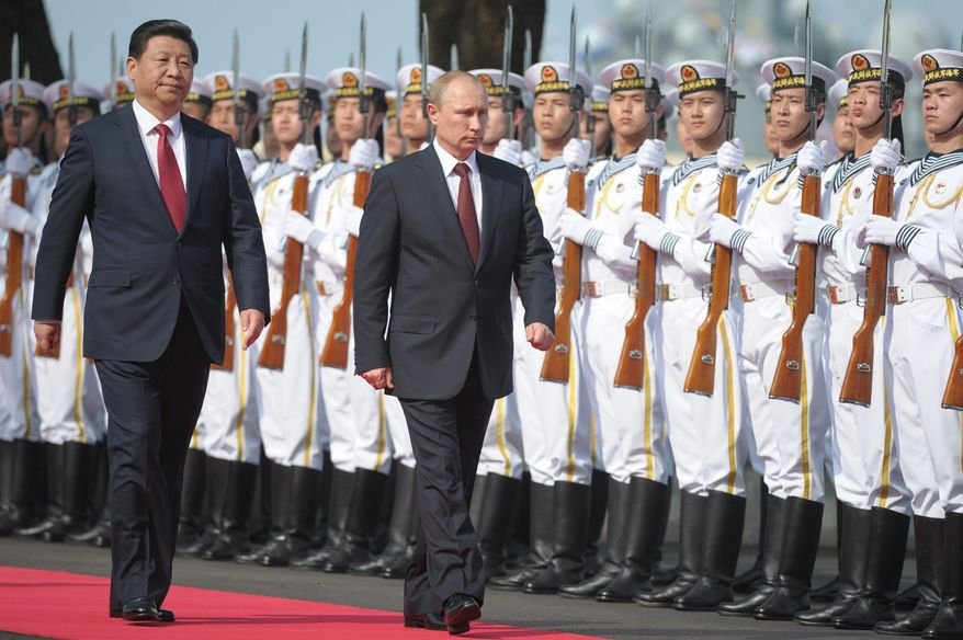 """Russian President Vladimir Putin and Chinese President Xi Jinping are said to have a budding """"bromance."""" Their nations plan joint naval exercises in the Mediterranean and cooperation in China's proposed development bank. (Associated Press)"""