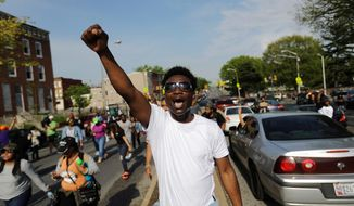 David Manigault chants while marching toward City Hall to protest the police-custody death of Freddie Gray in Baltimore. Police say they have turned over their criminal investigation to a prosecutor who will decide whether charges are warranted. (Associated Press)