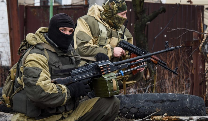"Russia-backed rebels take positions on the outskirts of Donetsk, Ukraine in April. Air Force Gen. Philip M. Breedlove said that Russia and pro-Russia separatist forces exploited the cease-fire to ""reset and reposition themselves"" in eastern Ukraine. (Associated Press) ** FILE **"
