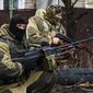 """Russia-backed rebels take positions on the outskirts of Donetsk, Ukraine in April. Air Force Gen. Philip M. Breedlove said that Russia and pro-Russia separatist forces exploited the cease-fire to """"reset and reposition themselves"""" in eastern Ukraine. (Associated Press) ** FILE **"""