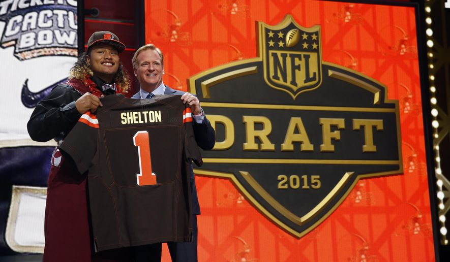 Washington defensive lineman Danny Shelton poses for photos with NFL commissioner Roger Goodell after being selected by the Cleveland Browns as the 12th pick in the first round of the 2015 NFL Draft,  Thursday, April 30, 2015, in Chicago. (AP Photo/Charles Rex Arbogast)