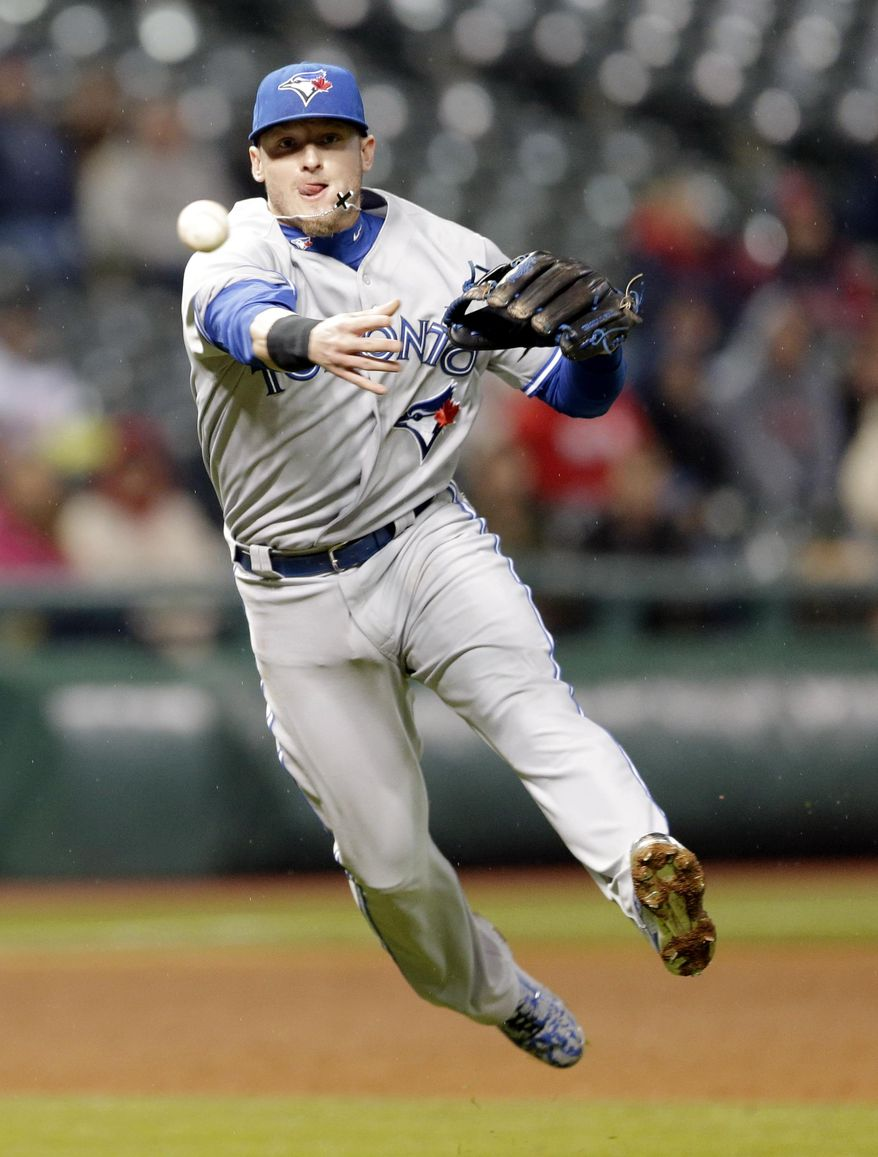 Toronto Blue Jays' Josh Donaldson throws out Cleveland Indians' Michael Bourn at first base in the sixth inning of a baseball game, Thursday, April 30, 2015, in Cleveland. (AP Photo/Tony Dejak)
