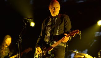 In this Dec. 14, 2014 file photo, Billy Corgan, of The Smashing Pumpkins, performs at the 25th annual KROQ Almost Acoustic Christmas at The Forum in Inglewood, Calif. Live Nation announced on Thursday, April 30, 2015, that the first National Concert Day will be held on May 5 in New York. (Photo by John Shearer/Invision/AP, File)