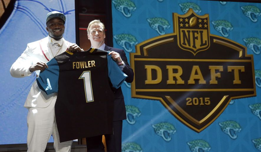 Florida defensive lineman Dante Fowler poses for photos with NFL commissioner Roger Goodell after being selected by the Jacksonville Jaguars as the thrid pick in the first round of the 2015 NFL Draft,  Thursday, April 30, 2015, in Chicago. (AP Photo/Charles Rex Arbogast)