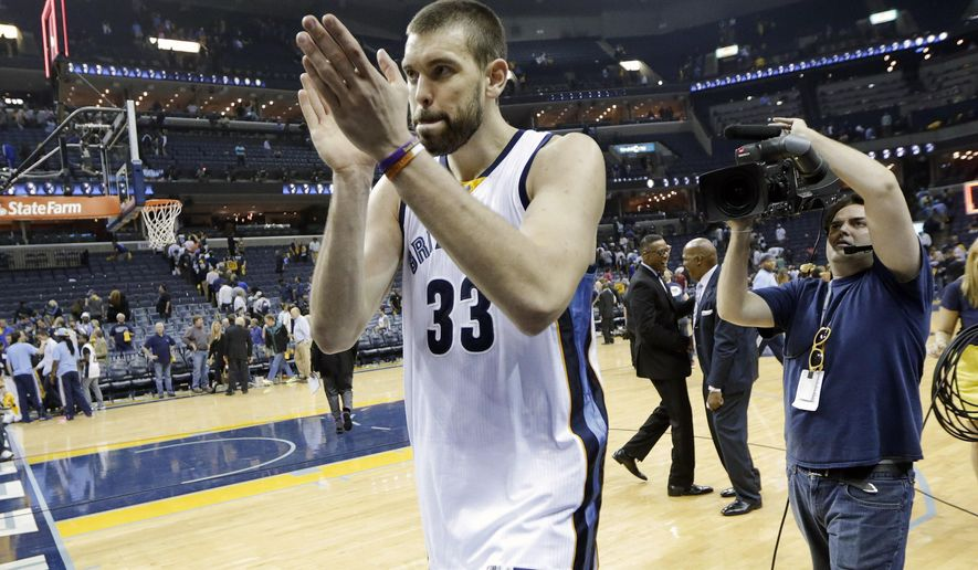 Memphis Grizzlies center Marc Gasol (33), of Spain, celebrates after beating the Portland Trail Blazers in Game 5 of an NBA basketball Western Conference playoff series Wednesday, April 29, 2015, in Memphis, Tenn. The Grizzlies won 99-93 to win the series 4-1. (AP Photo/Mark Humphrey)