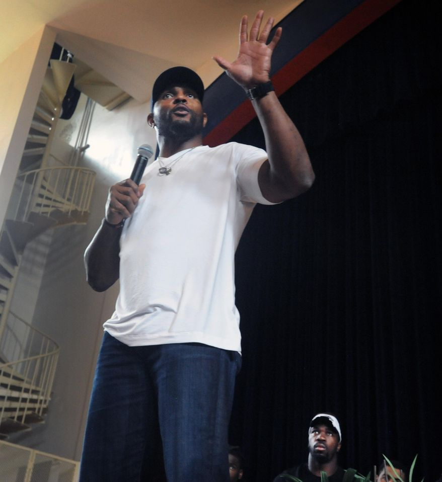 Former Baltimore Ravens NFL football player Ray Lewis talks to students at Frederick Douglass High School as Ravens C.J. Mosley looks on Thursday, April 30, 2015, in Baltimore. (Kenneth K. Lam/Baltimore Sun via AP)