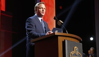 NFL commissioner Roger Goodell announces after the Tampa Bay Buccaneers selects Florida State quarterback Jameis Winston as the first pick in the first round of the 2015 NFL Draft,  Thursday, April 30, 2015, in Chicago. (AP Photo/Charles Rex Arbogast)