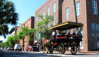 A horse-drawn carriage moves through the historic district in Charleston, South Carolina. In decades past, Charleston was largely unknown to visitors from the wider world. But now millions of people a year visit the city, which last year was named the top tourist destination in the United States and No. 2 in the world by the readers of Conde Nast Traveler. (AP Photo)