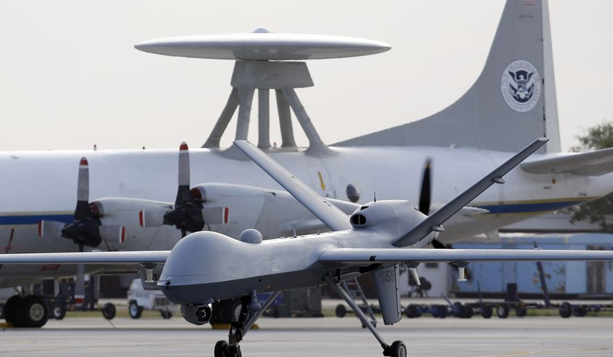 A Predator B unmanned aircraft taxis at the Naval Air Station in Corpus Christi, Texas. (Associated Press) ** FILE **