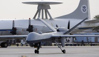A Predator B unmanned aircraft taxis at the Naval Air Station in Corpus Christi, Texas. (Associated Press)