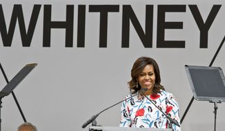 First lady Michelle Obama speaks during a ribbon-cutting ceremony for the new $422 million Renzo Piano-designed Whitney Museum of American Art, Thursday, April 30, 2015, in New York. (AP Photo/Bebeto Matthews)