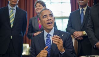 President Barack Obama speaks in the Oval Office of the White House in Washington, Thursday, April 30, 2015, before signing bill S. 535 Energy Efficiency Improvement Act of 2015. (AP Photo/Pablo Martinez Monsivais) ** FILE **