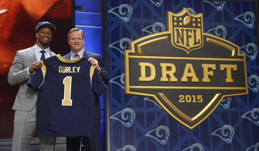 Georgia running back Todd Gurley poses for photos with NFL commissioner Roger Goodell after being selected by the St. Louis Rams as the 10th pick in the first round of the 2015 NFL Draft,  Thursday, April 30, 2015, in Chicago. (AP Photo/Charles Rex Arbogast)