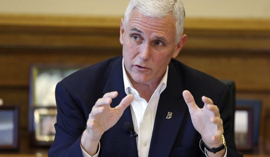 Indiana Gov. Mike Pence discusses the legislative session that ended the day before during a press conference at the Statehouse in Indianapolis, Thursday, April 30, 2015. (AP Photo/Michael Conroy)