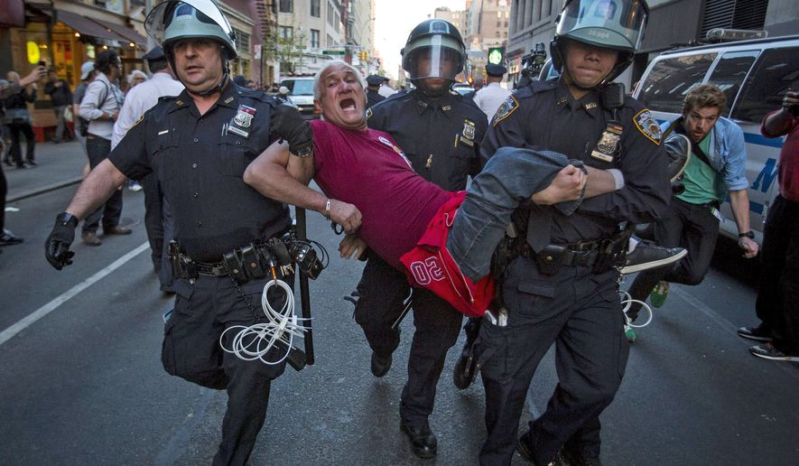 A protester is detained by New York police during a demonstration calling for social, economic and racial justice, in the Manhattan borough of New York City April 29, 2015. The demonstration was being held to support Baltimore's protest against police brutality following the April 19 death of Freddie Gray in police custody. REUTERS/Andrew Kelly      TPX IMAGES OF THE DAY
