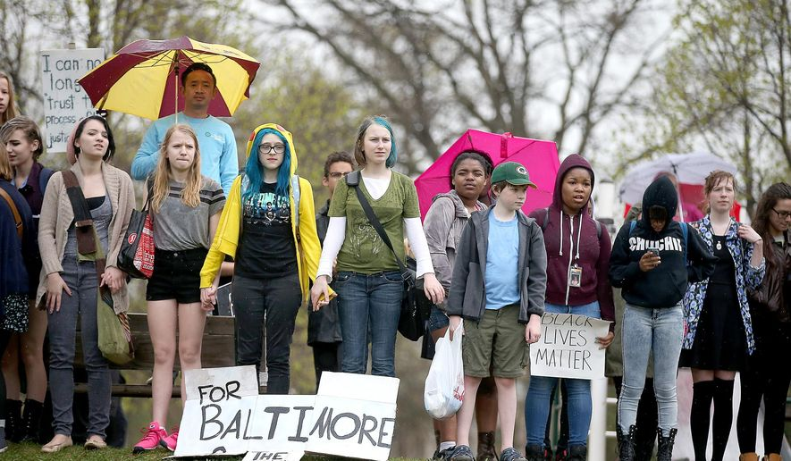 Student protestors from the Twin Cities and some suburbs gathered at Martin Luther King Park Friday, May 1, 2015, in Edina, Minn, in support of protesters arrested in December at the Mall of America. (Elizabeth Flores/Star Tribune via AP)  MANDATORY CREDIT; ST. PAUL PIONEER PRESS OUT; MAGS OUT; TWIN CITIES LOCAL TELEVISION OUT